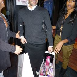 Marc Jacobs makes his entrance with two of many bags filled with toys