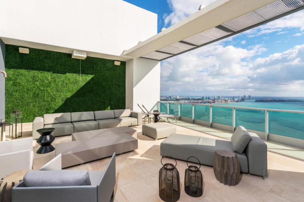 A rooftop deck with a bay view