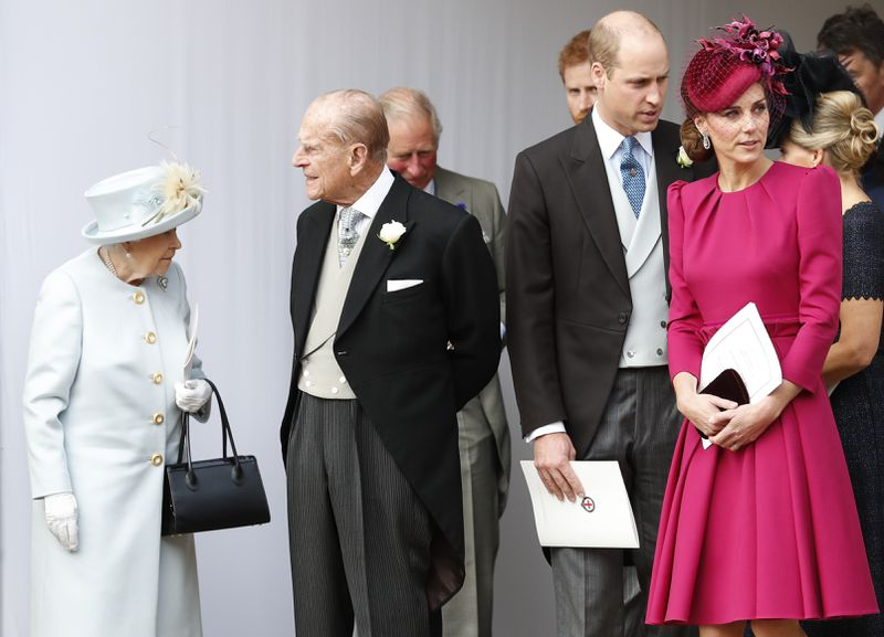 Middleton stands with Prince William and the Queen.