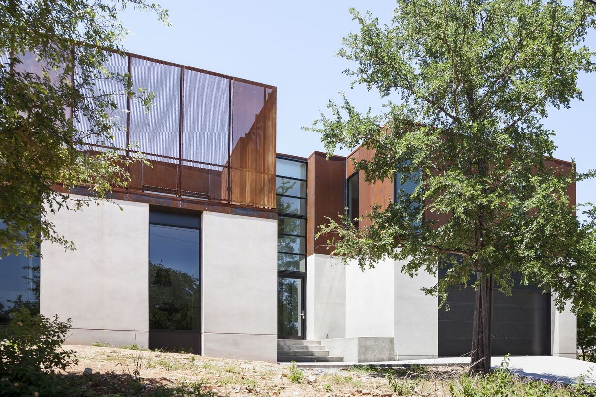 New contemporary, two stories, two connected houses, white stucco first floor, deck with Corten screen and Corten walls second floor