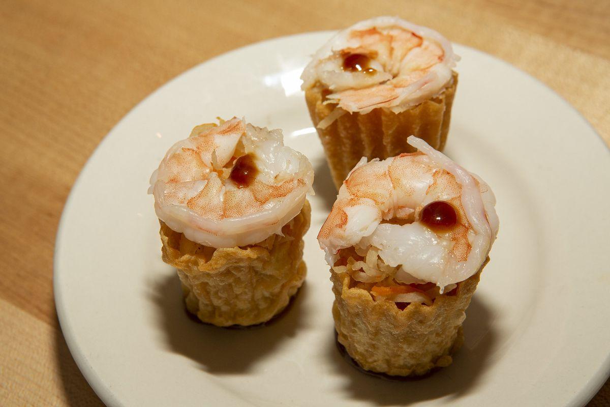 An appetizer canapé with shrimp.
