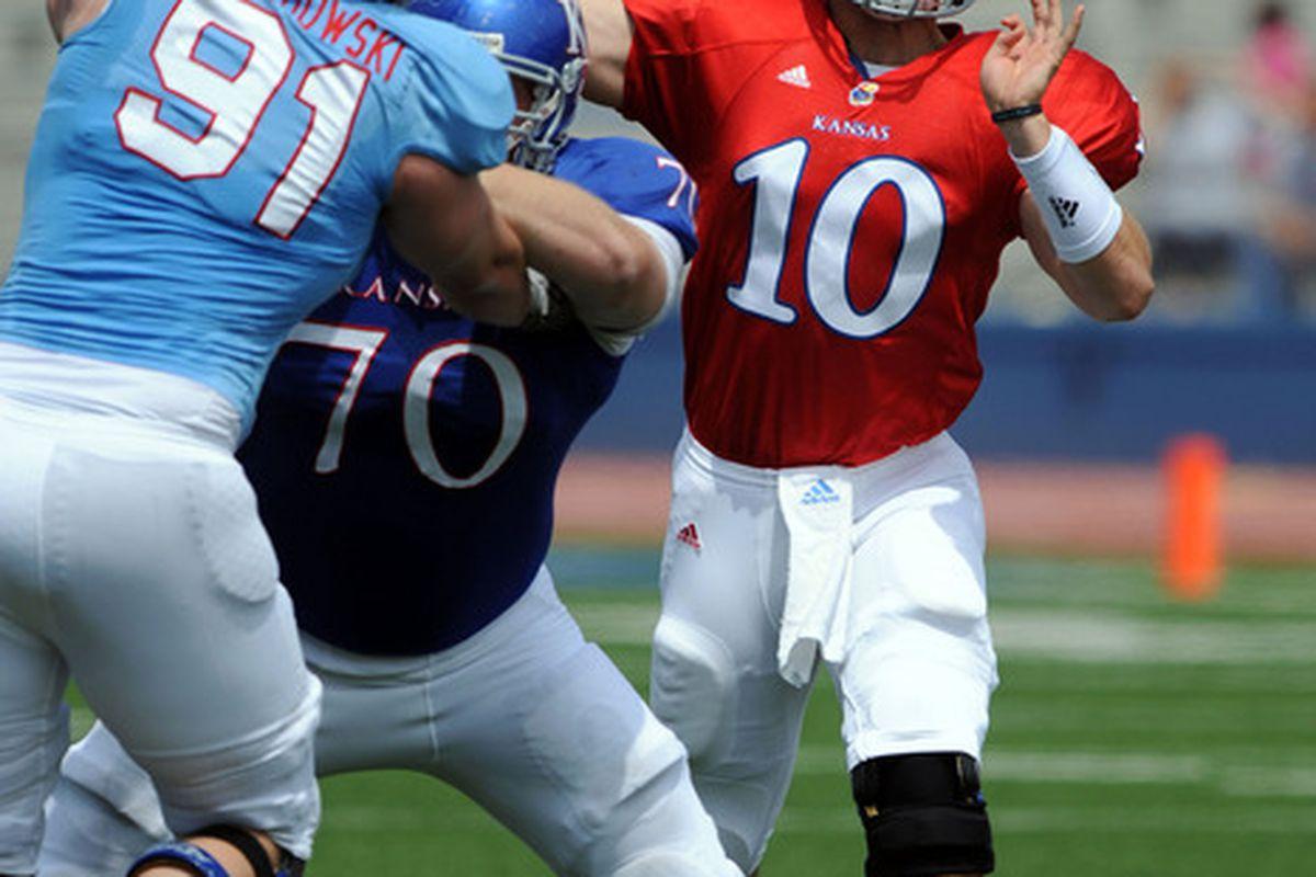 Apr 28, 2012; Lawrence, KS, USA; Kansas Jayhawks quarterback Dayne Crist (10) drops back to pass in the second half of the Spring Game at Memorial Stadium. Mandatory Credit: John Rieger-US PRESSWIRE