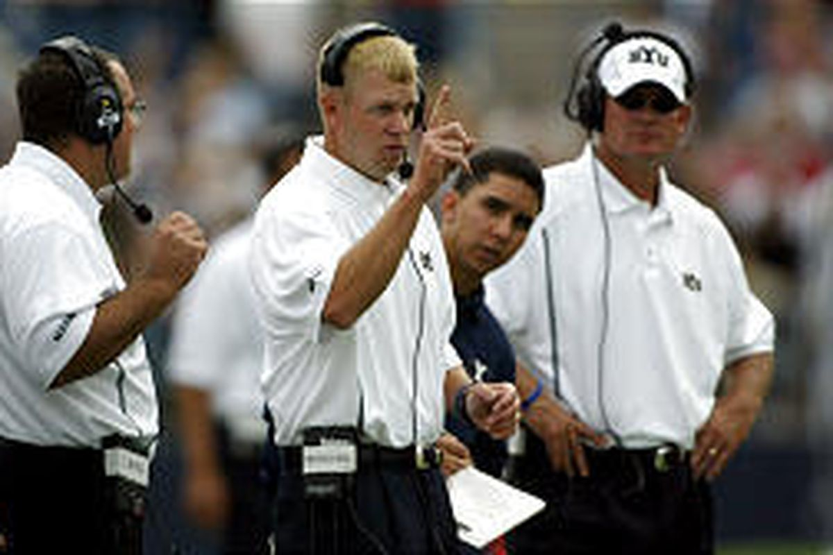 BYU head coach Bronco Mendenhall sends in a defensive play during BYU's loss Saturday in Provo against Boston College.