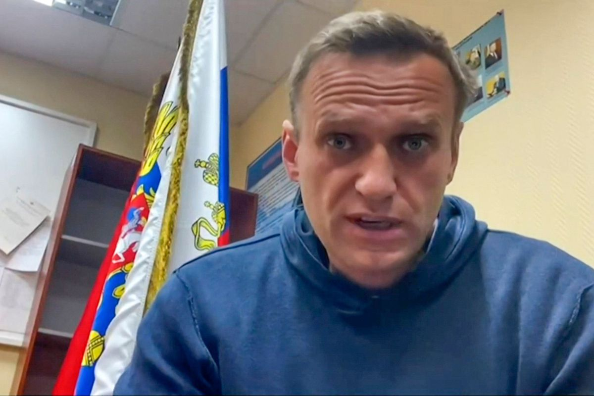 This grab taken from a video made available on January 18, 2021 on Navalny team Youtube page shows Russian opposition leader Alexei Navalny speaking while waiting for a court hearing at a police station in Khimki outside Moscow.