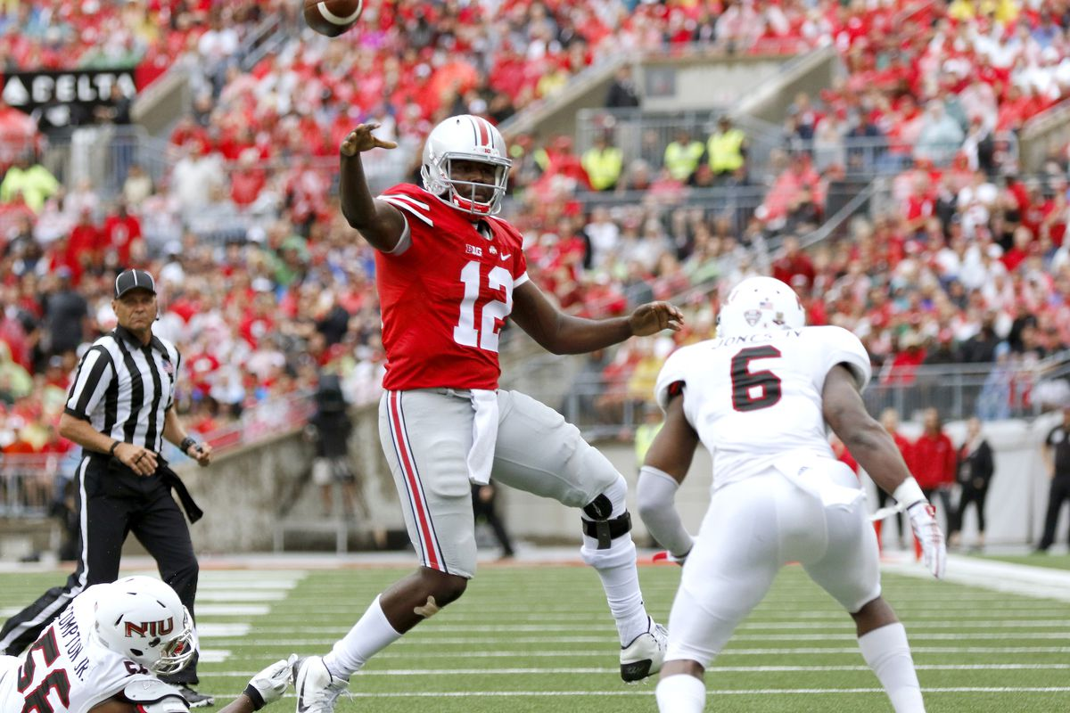 Cardale Jones throws under pressure in Ohio State's game against Northern Illinois on Saturday.