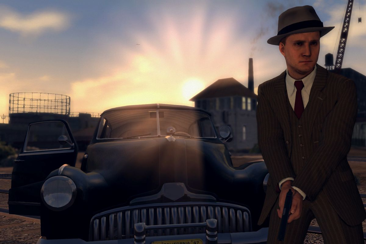 L.A. Noire on Nintendo Switch - Cole holding gun in front of car at sunset