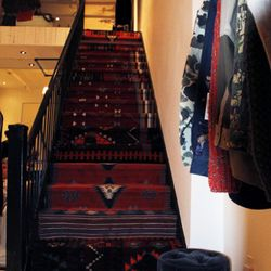 Staffers from the Reformation bought Turkish carpets online and cut them up to cover the stairs.