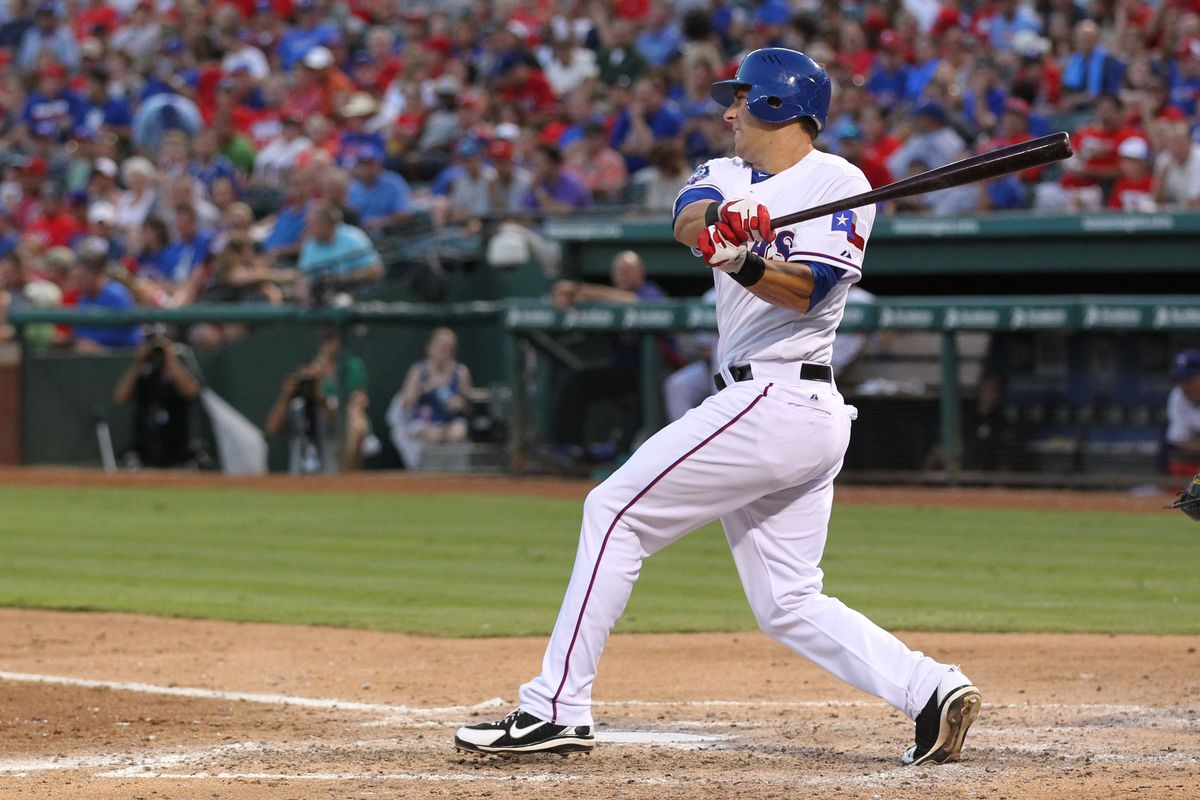 Aug 2, 2012; Arlington, TX, USA; Texas Rangers rookie first baseman Mike Olt (9) at bat in the third inning against the Los Angeles Angels at Rangers Ballpark.  This game was Olt's first in the majors. Mandatory Credit: Matthew Emmons-US PRESSWIRE