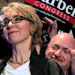 FILE - In this June 12, 2012 file photo, former Arizona Rep. Gabrielle Giffords, accompanied by her husband Mark Kelly, are seen in Tucson, Ariz. Giffords will deliver the Pledge of Allegiance at the Democratic convention .Giffords' office confirms she will deliver the pledge Thursday, the final night of the convention in Charlotte, N.C.