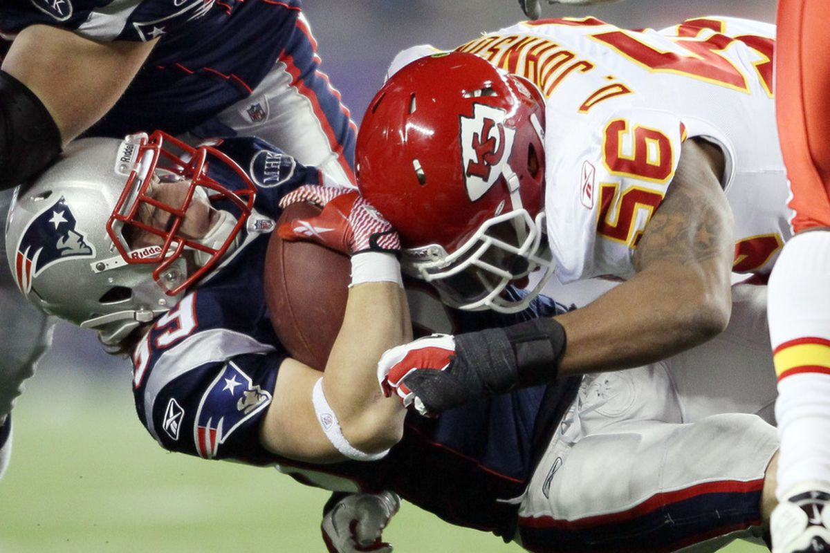 FOXBORO, MA - NOVEMBER 21:  Danny Woodhead #39 of the New England Patriots is hit by Derrick Johnson #56 of the Kansas City Chiefs  on November 21, 2011 at Gillette Stadium in Foxboro, Massachusetts.  (Photo by Elsa/Getty Images)