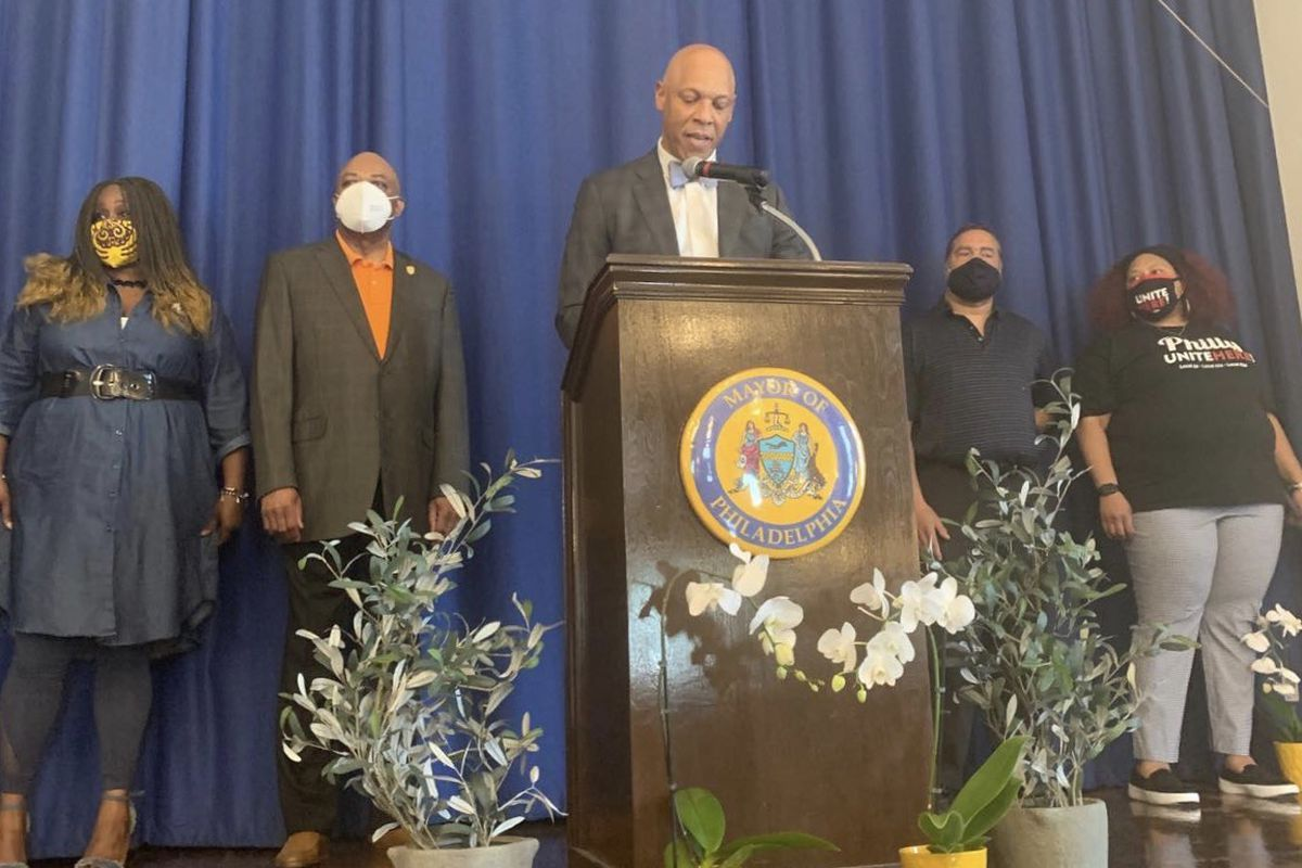 Superintendent William Hite, center, with Robin Cooper, left, president of Teamsters Local 502/CASA, Jerry Jordan, president of Philadelphia Federation of Teachers, Royce Merriweather, of the union representing school safety officers and Nicole Hunt, right, president of Local 634.