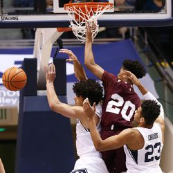 BYU guard Elijah Bryant (3) and BYU forward Yoeli Childs (23) defend Texas Southern  guard Cainan McClelland (20) as BYU and Texas Southern play an NCAA basketball game in Provo at the Marriott Center on Saturday, Dec. 23, 2017.