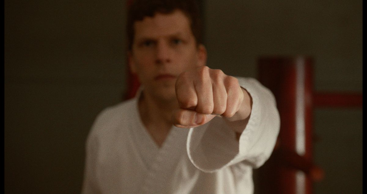 Jesse Eisenberg throws a punch.