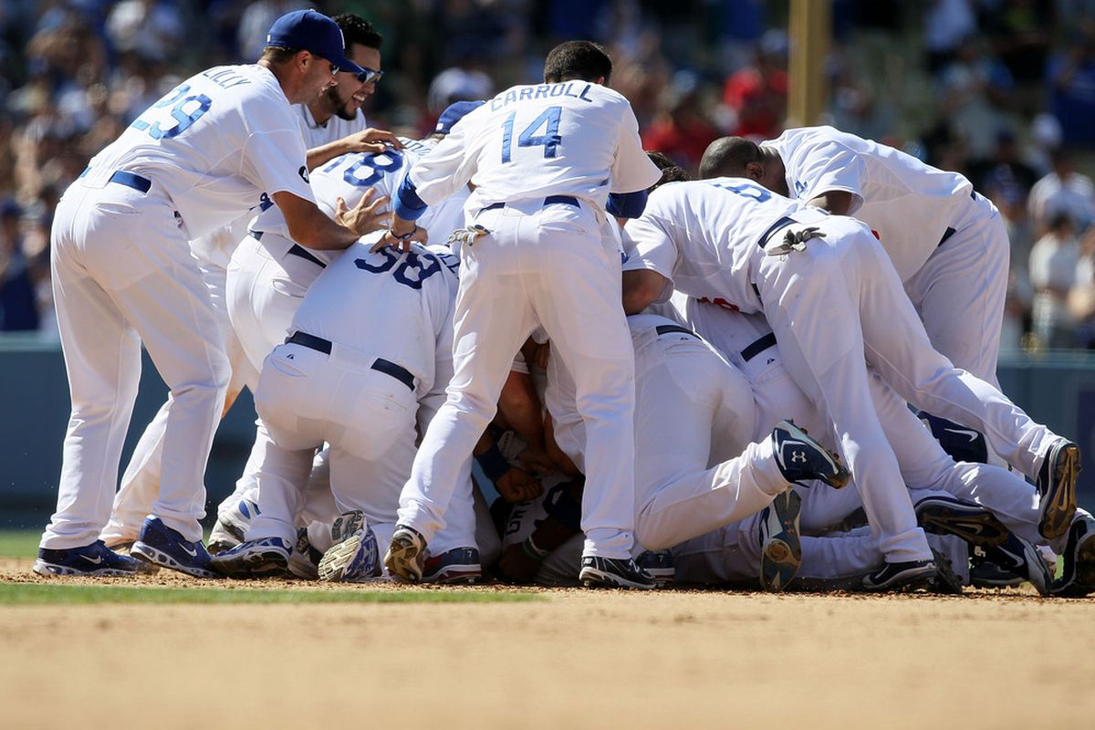 The Dodgers finally vent their repressed frustration by gang-tackling Frank McCourt.