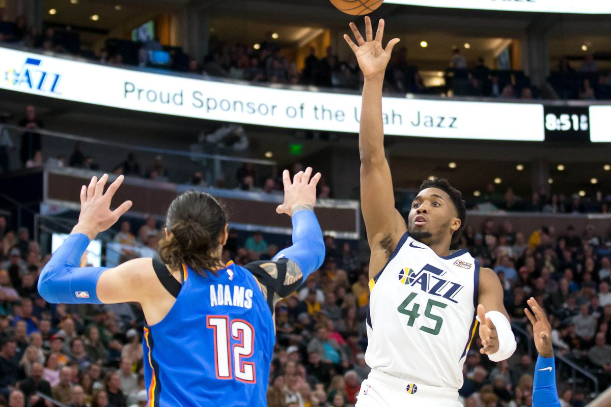 Utah Jazz guard Donovan Mitchell shoots the ball against Oklahoma City Thunder center Steven Adams during the second half at Vivint Smart Home Arena.