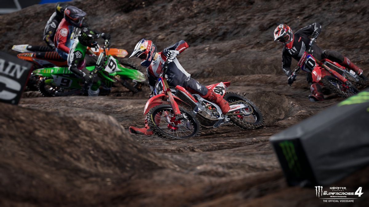 five riders negotiate a banked turn in Monster Energy Supercross 4