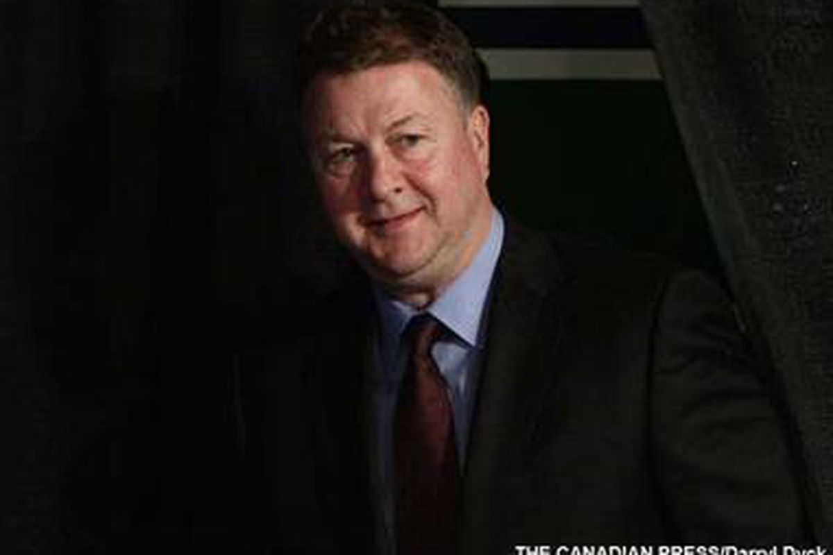 """This may be the only picture on the planet where MG is somewhat smiling. [via <a href=""""http://www.sportsnet.ca/hockey/2011/02/16/gillis_mike487_381.jpg"""">www.sportsnet.ca</a>]"""