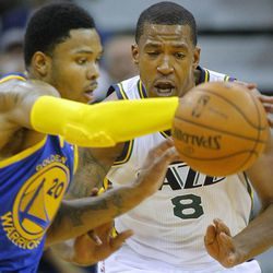 Warriors' kent Bazemore beats Utah's Lester Hudson to a lose ball as the Utah Jazz and the Golden State Warriors play Tuesday, Oct. 8, 2013 in preseason action at Energy Solutions arena in Salt Lake City.