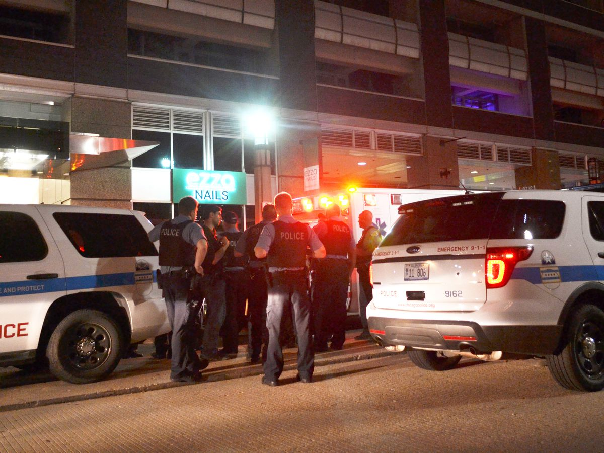 Police investigate a shooting about 12:30 a.m. Friday, August 17, 2018 in the 200 block of East Illinois St. in Chicago. | Justin Jackson/ Sun-Times
