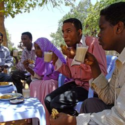 In this photo taken Saturday, March 31, 2012, customers drink coffee at an outdoor cafeteria in Mogadishu, Somalia. The seaside capital of Mogadishu is full of life for the first time in 20 years after African Union and Somali troops pushed Islamist militants out of the city last year.