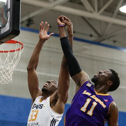 Salt Lake City Stars center Da'Shonte Riley (33) and Los Angeles D-Fenders guard David Nwaba (11) compete for a rebound at the Lifetime Activities Center in Taylorsville on Wednesday, Feb. 08, 2017.