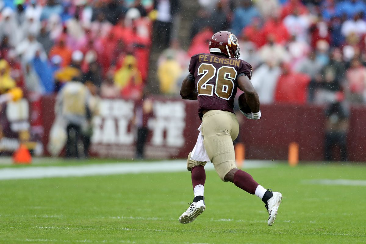 Washington running back Adrian Peterson #26 carries the ball against the San Fransisco 49ers at FedExField on October 20, 2019 in Landover, Maryland.