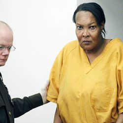 Morris Garner, who also goes by the name Tracey Lynn Garner, is escorted into a Hinds County courtroom by bailiff Tony Queen in Jackson, Miss., Tuesday, Sept. 11, 2012, for a bond hearing.  Garner, who dresses and lives as a woman, has been charged with depraved-heart murder after performing an illegal buttocks implant that killed a Georgia woman, authorities said. He is charged with performing the procedure in March at his house in Jackson, Miss. Mississippi Attorney General Jim Hood said during a news conference that Garner had no training or license to perform such a procedure.
