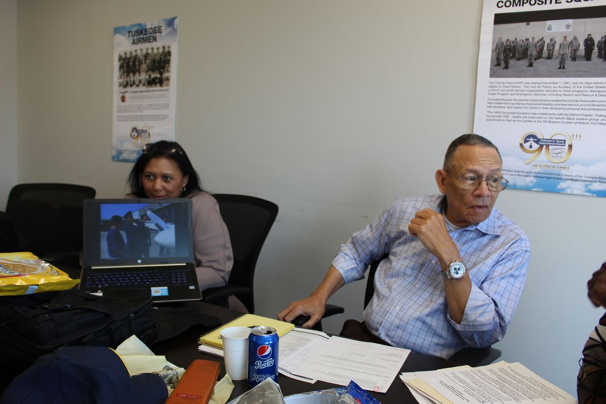 Millben, right, at a meeting of the Davis Aerospace Technical Advisory Committee. The group continued to meet regularly over Oreos even after its relationship with the district soured.