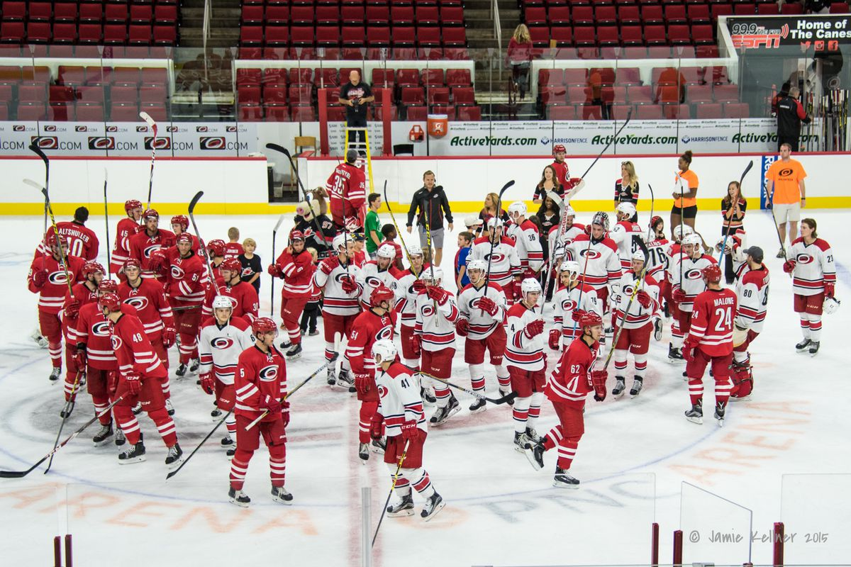 Players salute fans after the Red-White Scrimmage on Sunday