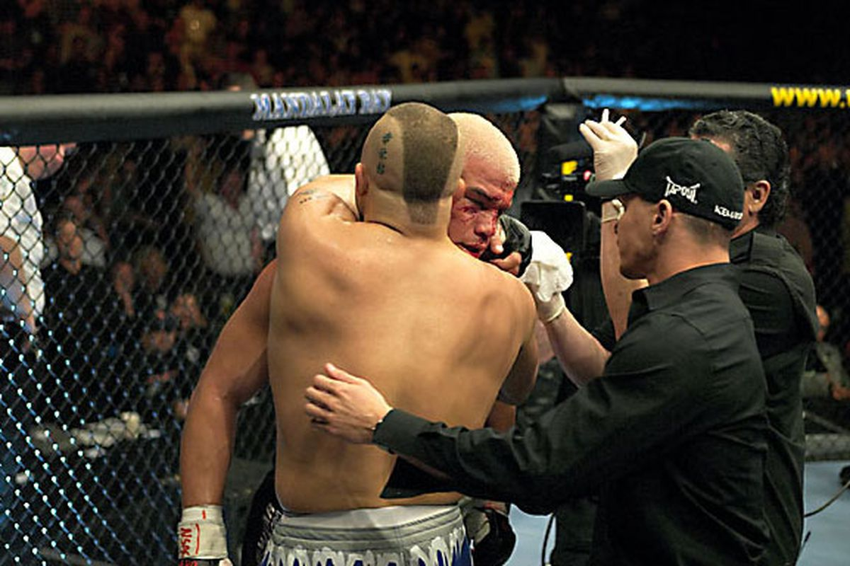 Chuck Liddell hugs Tito Ortiz shortly after beating him up in their first fight at UFC 47 on April 2, 2004.