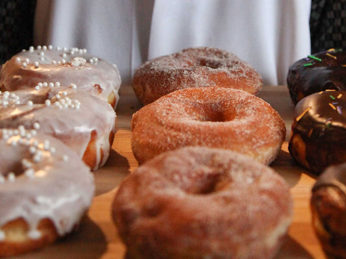 """<span data-author=""""2187660"""">District: Donuts. Sliders. Brew. </span>"""