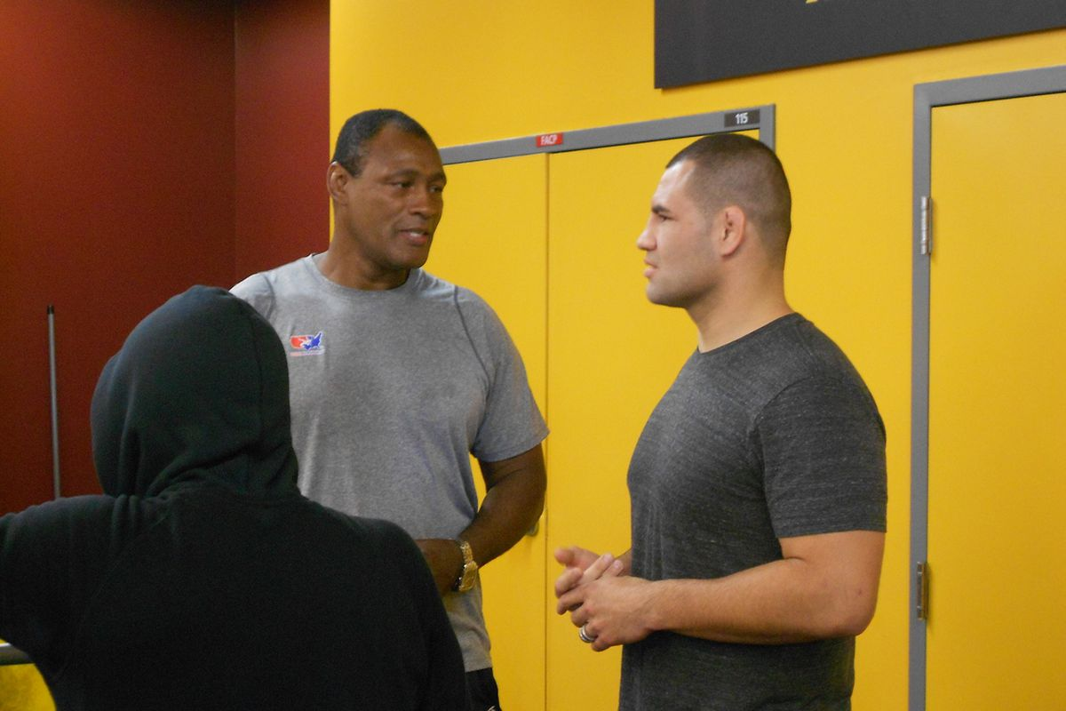 Cain Velasquez chats with a friend at ASU Tuesday.