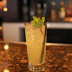 Le-Mint: fresh lemon, sugar, mint, vodka, gin, floated with yellow Chartreuse