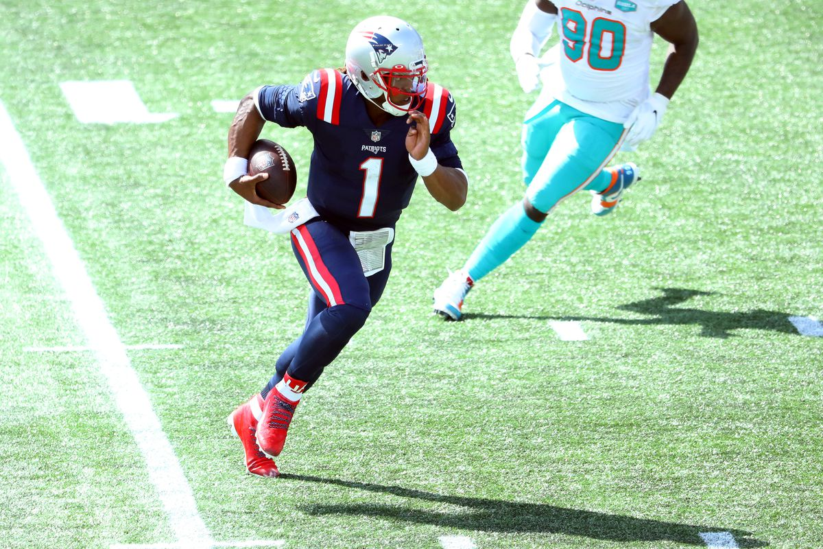 Cam Newton of the New England Patriots runs with the ball during the first half against the Miami Dolphins at Gillette Stadium on September 13, 2020 in Foxborough, Massachusetts.