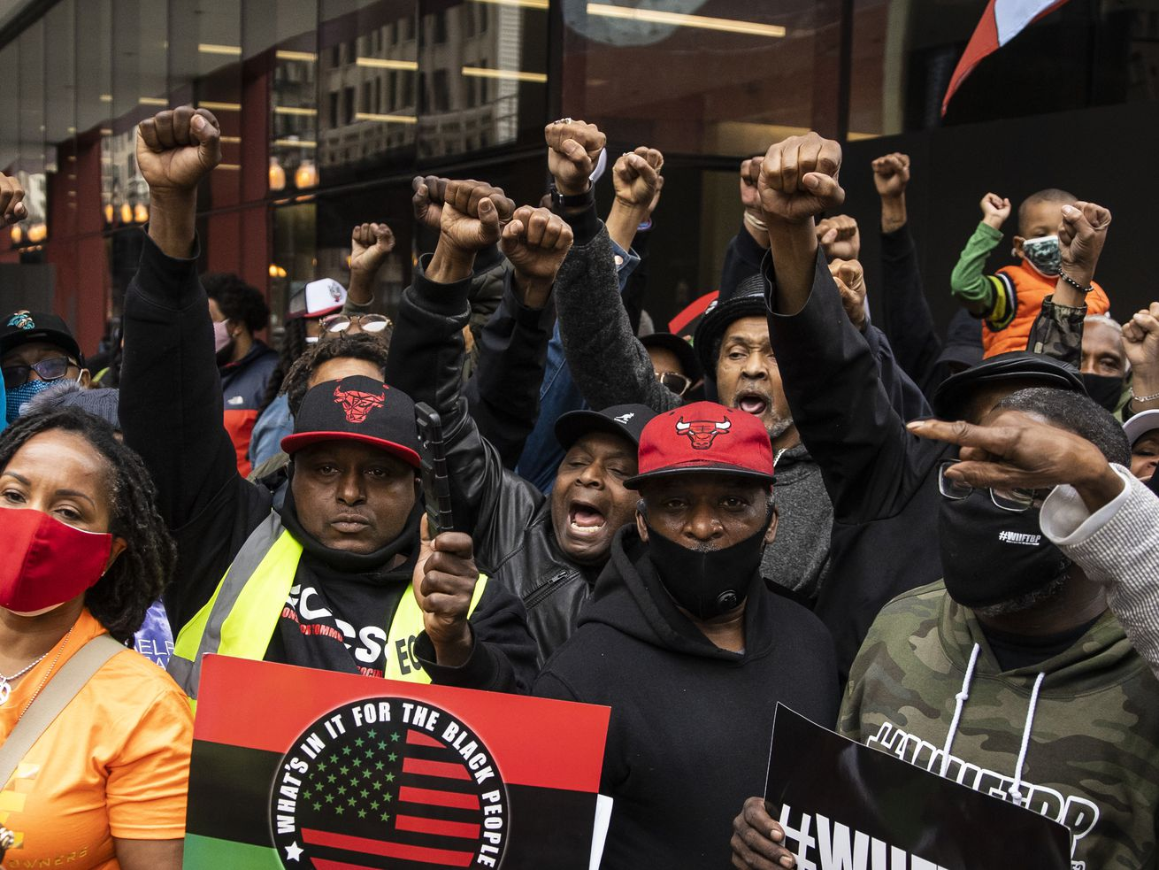 More than a hundred people gather for a rally outside the Chicago Housing Authority headquarters in the Loop, to decry economic disparities for black communities in the city, Monday morning, May 3, 2021.