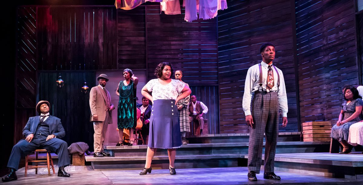 "Nicole Michelle Haskins (as Sofia, center) and  Gilbert Domally (right, as Harpo) and the ensemble cast in a scene from ""The Color Purple"" at Drury Lane Theatre."