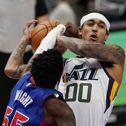 Detroit Pistons guard Delon Wright (55) reaches in against Utah Jazz guard Jordan Clarkson (00) during the first half of an NBA basketball game, Sunday, Jan. 10, 2021, in Detroit.