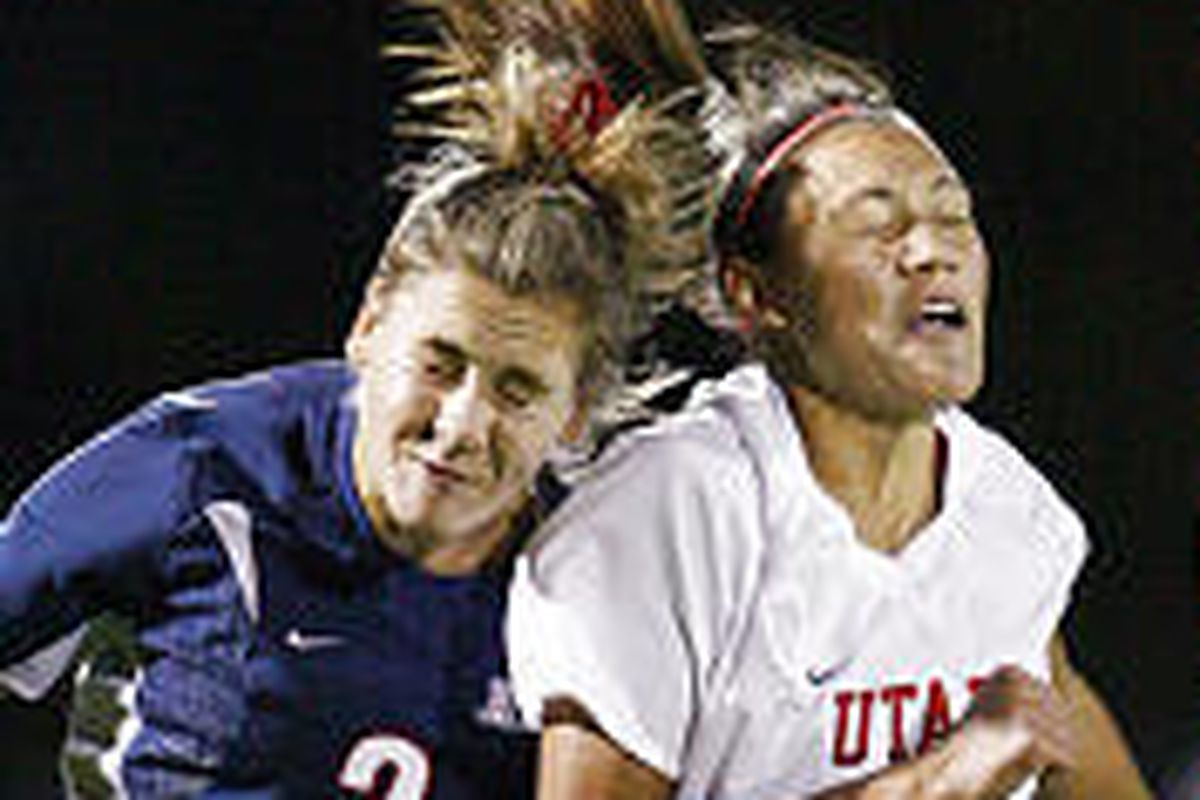 University of Utah's Adele Letro and University of Arizona's Claire Bodiya head the ball in the first round of the NCAA tournament.