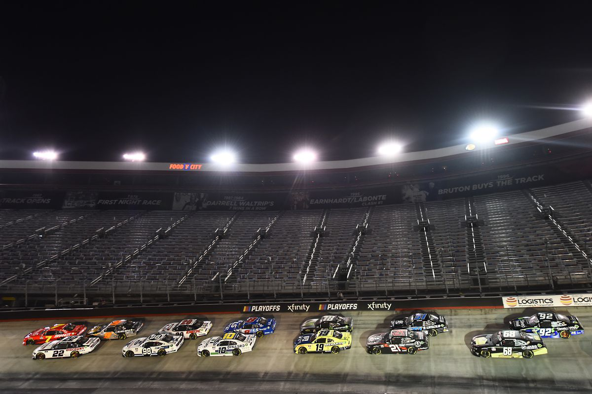 Justin Allgaier, driver of the #7 BRANDT Chevrolet, Austin Cindric, driver of the #22 Discount Tire Ford, and Noah Gragson, driver of the #9 Bass Pro Shops/Black Rifle Coffee Chevrolet, lead the field during the NASCAR Xfinity Series Food City 300 at Bristol Motor Speedway on September 18, 2020 in Bristol, Tennessee.