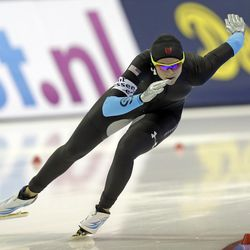 Brittany Bowe, of the United States, skates in the women's 1,000-meter competition at the World Cup speedskating event Sunday, Nov. 17, 2013, in Kearns, Utah. Bowe came in first place.