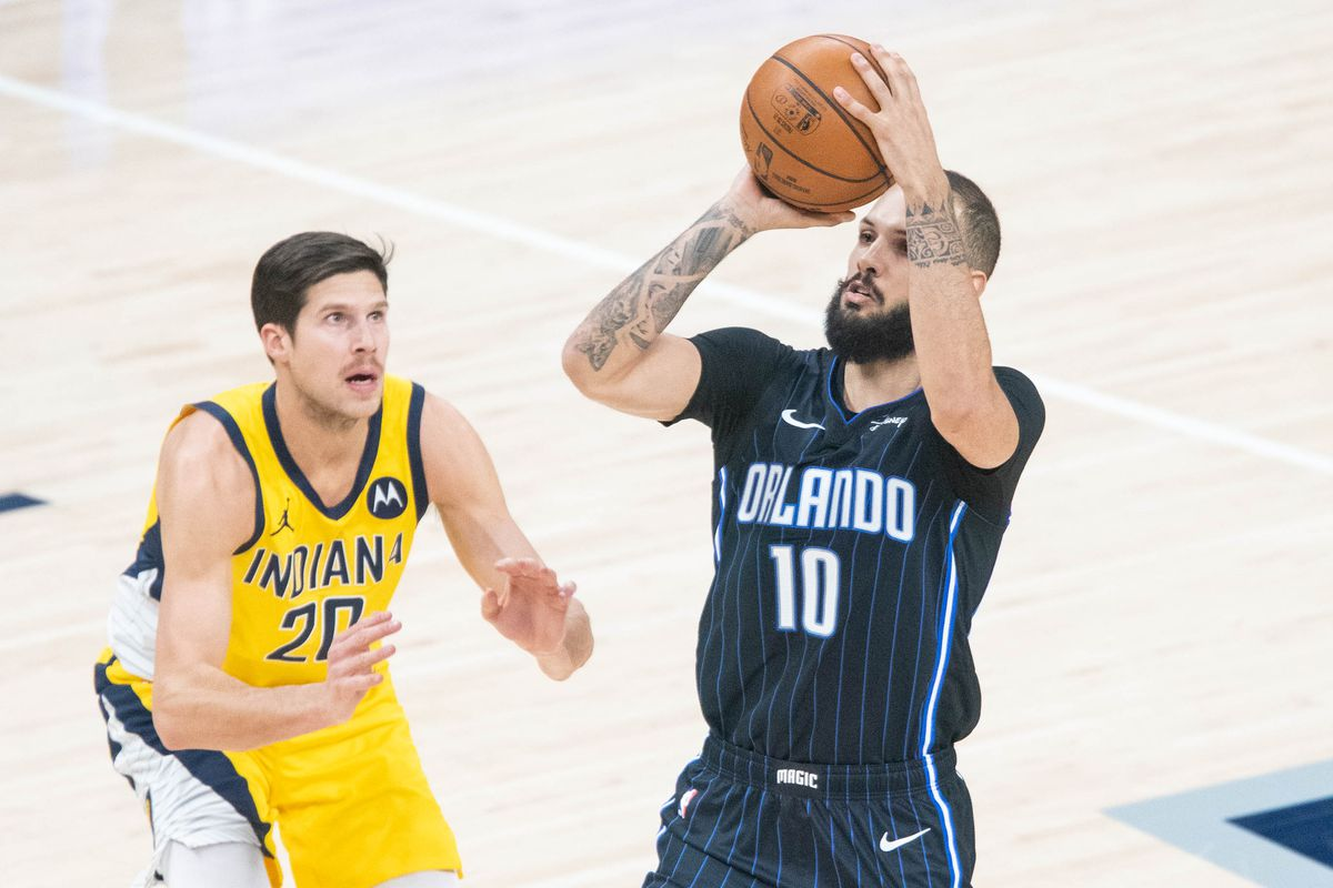 Orlando Magic guard Evan Fournier (10) shoots the ball while Indiana Pacers forward Doug McDermott (20) defends in the second quarter at Bankers Life Fieldhouse.