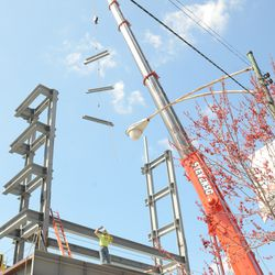 1:53 p.m. Steel girders being lifted up to the right-field video board structure -