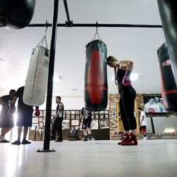 Boxer Whitney Gomez gets a rest during her workout on the heavy bag at Fullmer Brothers Boxing Gym in South Jordan on Wednesday, June 7, 2017.