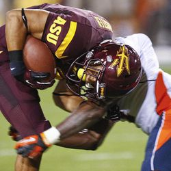Arizona State running back D.J. Foster, left, is stopped by llinois defensive back Patrick Nixon-Youman during the first half of an NCAA college football game, Saturday, Sept. 8, 2012,in Tempe, Ariz.