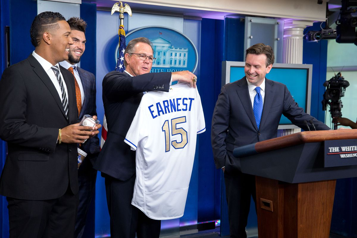Ned Yost, Manager of the 2015 World Series champion Kansas City Royals, along with Royals Salvador Perez and Eric Hosmer surprise Press Secretary Josh Earnest at the regular morning media briefing with a personalized team jersey, in the James Brady Briefing Room of the White House, July 21, 2016. Earnest, a Kansas City native and Royals fan, later attended an East Room ceremony honoring the 2015 World Series Champions.