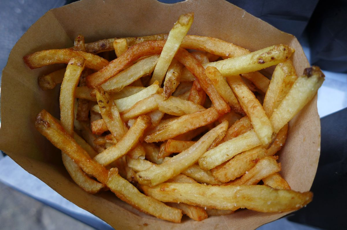 A brown cardboard box filled with french fries.