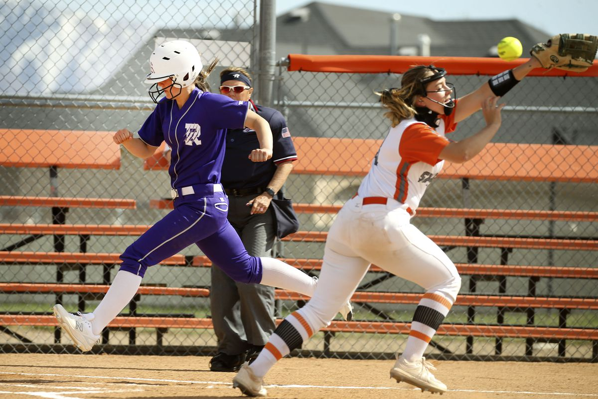 Riverton's 10 Kyli Carrell scores before Murray's catcher Jasmine Vera can tag her at Riverview Junior High in Murray on Wednesday, April 7, 2021.