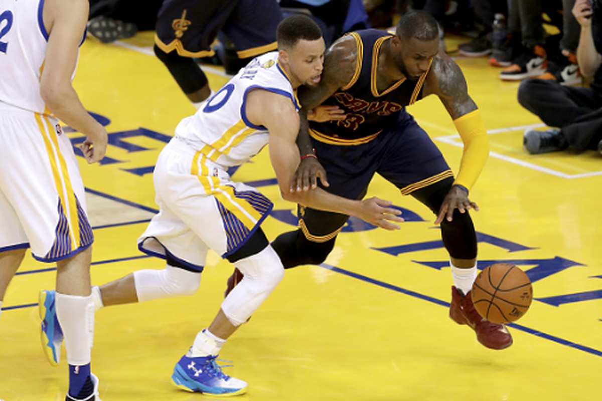 eb50d3bd7b37 Stephen Curry and LeBron James go after a loose ball in the first half of Game  1 of the 2016 NBA Finals.