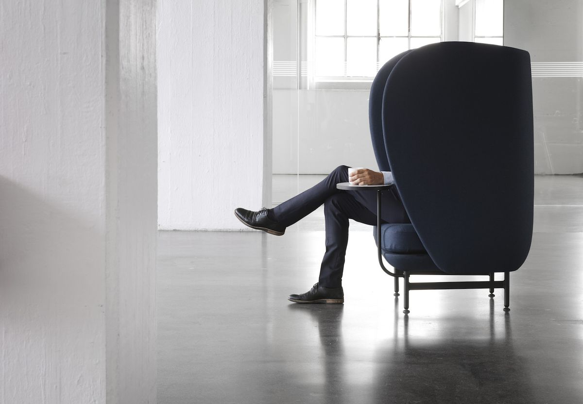 Man sitting in chair with coffee