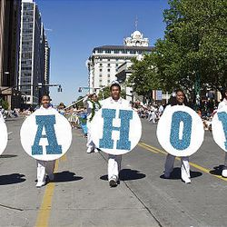 The Liahona Alumni Band performs in the parade as spectators watch the floats, horses and celebrities participate in the Days of '47 Parade in Salt Lake City Saturday.